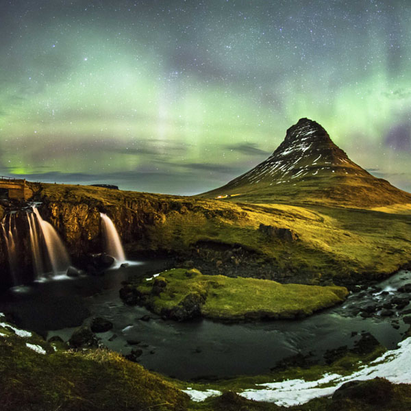 "Print advertisement featuring a night-time Icelandic landscape and the words, ""Win this trip to Iceland or $10,000 cash."""