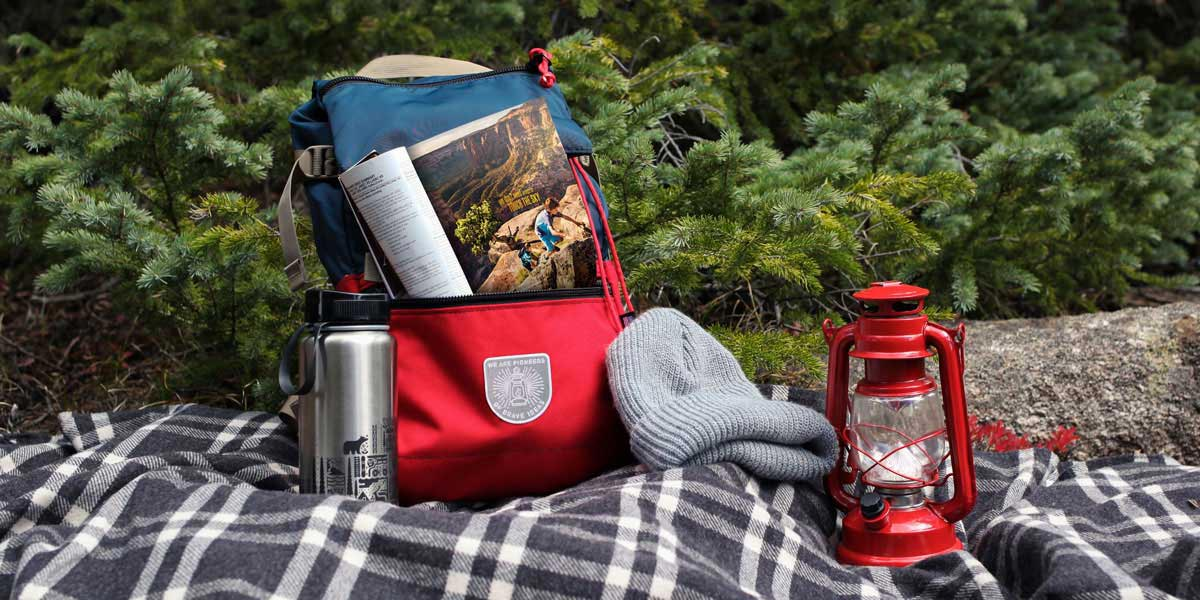 Outdoor scene with a red backpack and lantern.