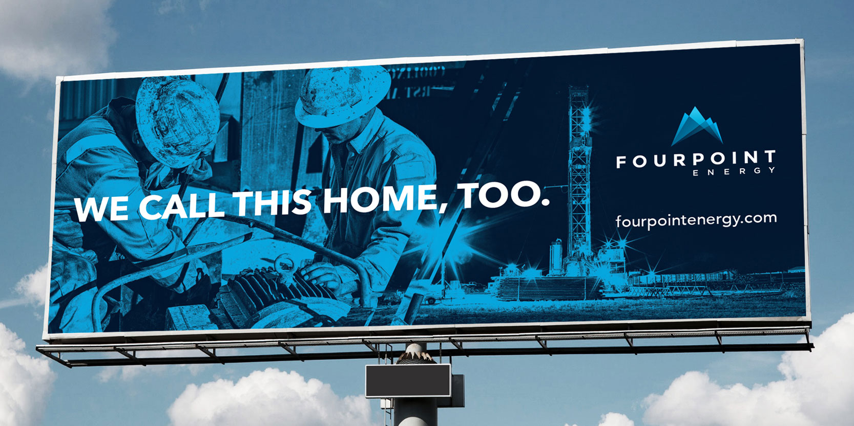 "Highway billboard featuring featuring oil rig workers and the words ""We this home, too."""