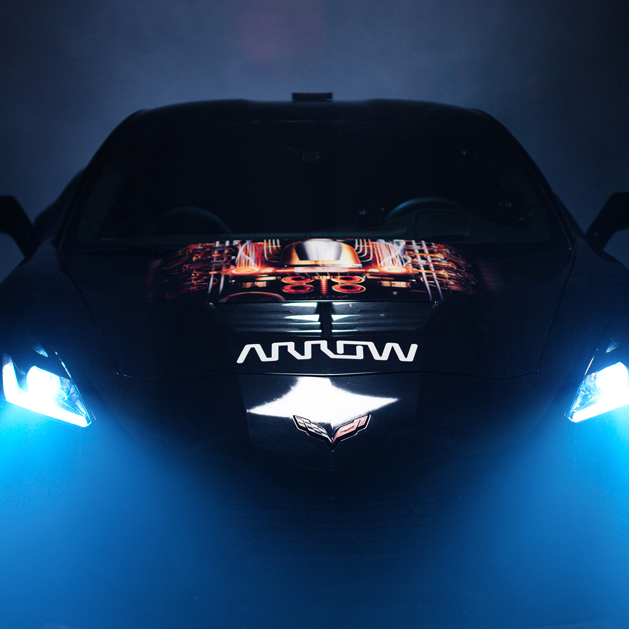 Dramatically lit shot of the Arrow SAM race car with bright headlights.