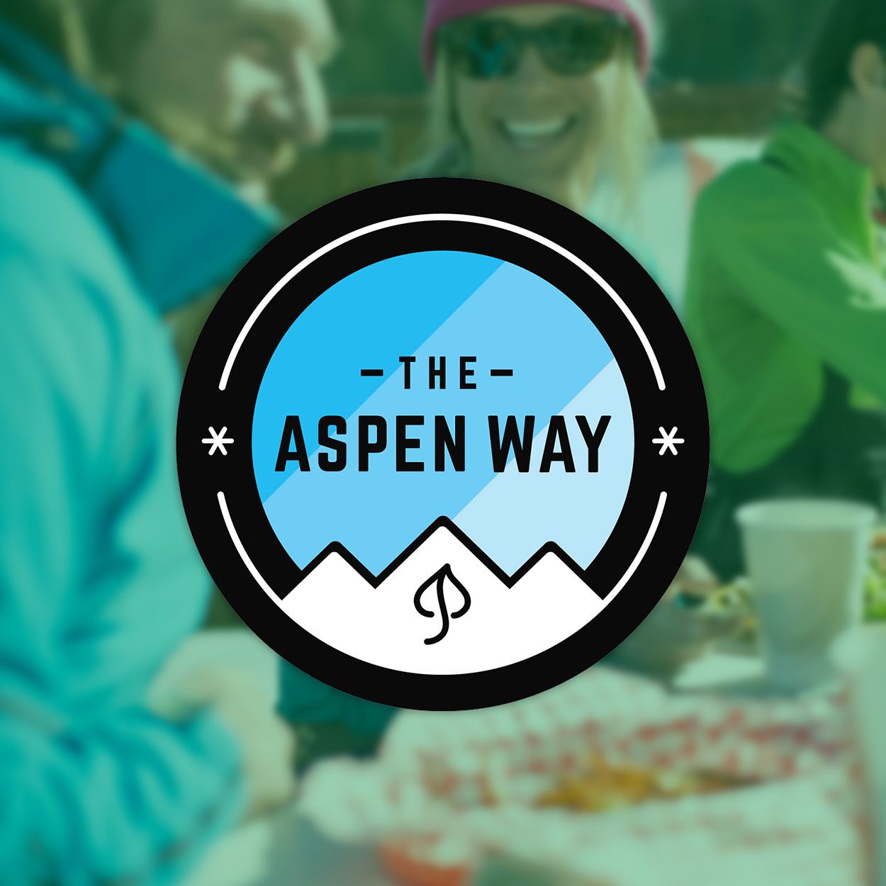 "Several illustrated badges with the words, ""Respect, Unity, Love, Commit, The Aspen Way."""