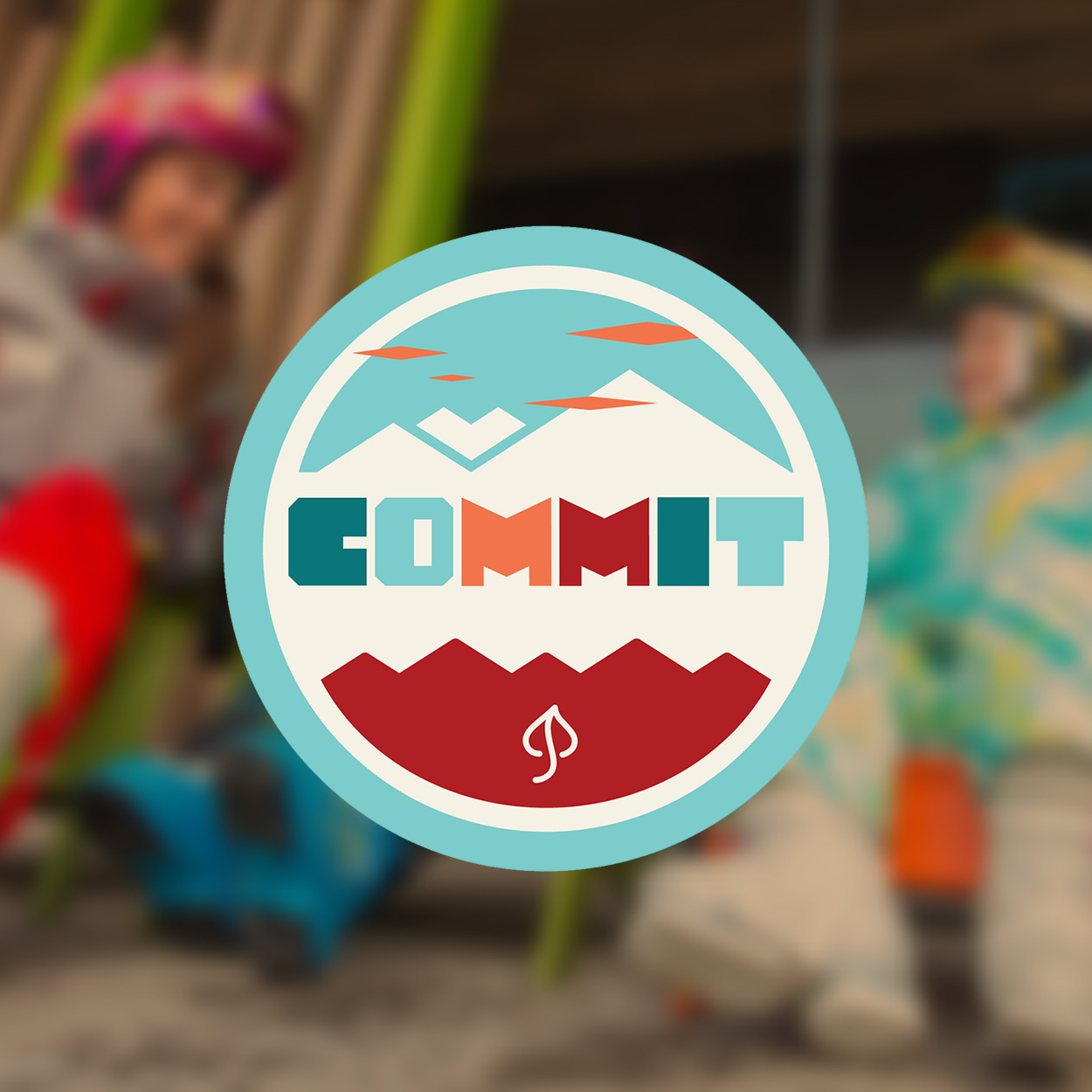 "Skier sailing over large 3D letters that spell ""Commit."""
