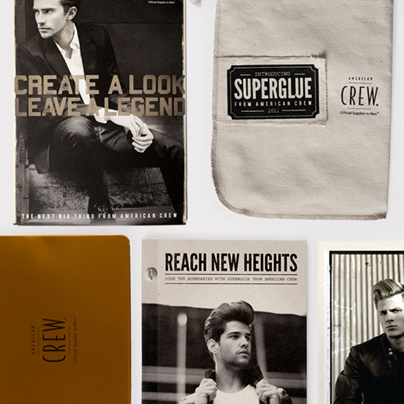 Several pieces of collateral featuring black and white photographs and stylized typography.