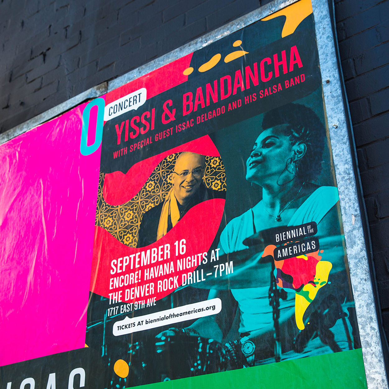 Outdoor shot of a concert poster for Yissi & Bandancha.