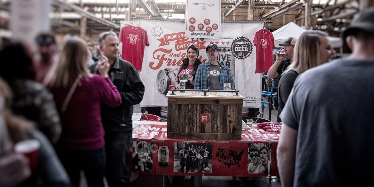 Live-action photograph of a Diver Bar Beer merchandise booth during a brewery tour.