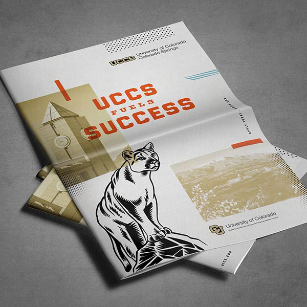 "A ""UCCS Fuels Success"" pamphlet featuring an illustrated mountain lion and stylized images of campus."
