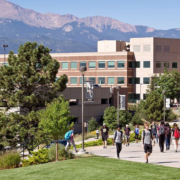 Long shot of the UCCS campus nestled beneath a mountain range.