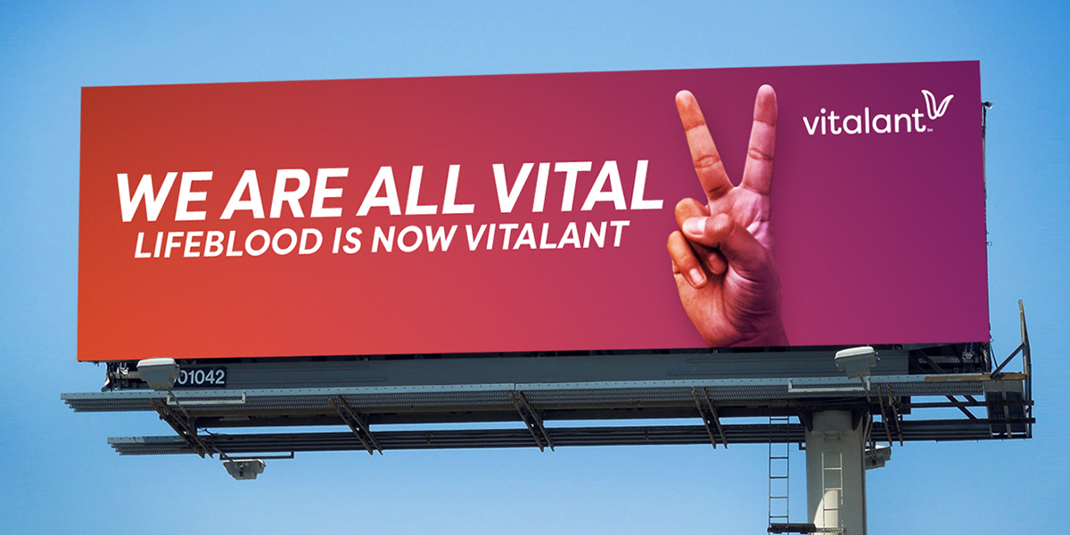 billboard mockup featuring hand with peace sign on orange and purple gradient