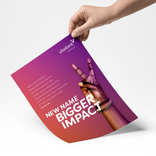 photo of hand holding poster with we are vital messaging