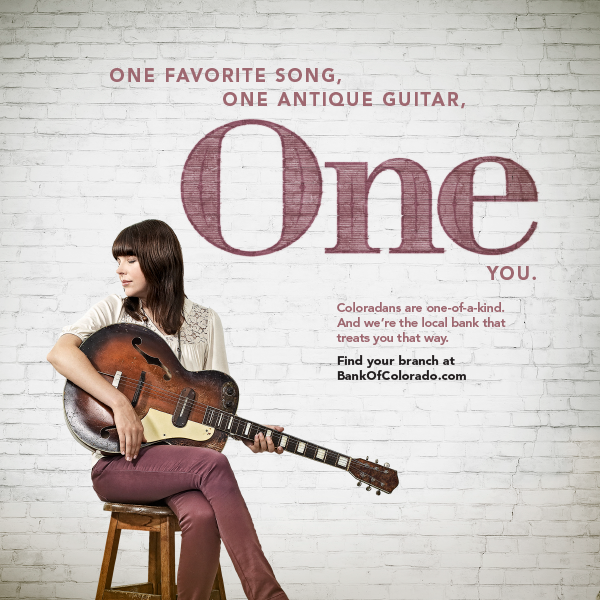 "Magazine advertisement featuring a young women sitting on a stool with a guitar and the words, ""One favorite song, one antique guitar, one you."""
