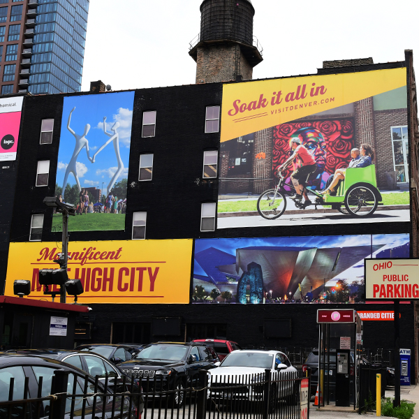 Big outdoor building placements for VISIT DENVER creative in Chicago