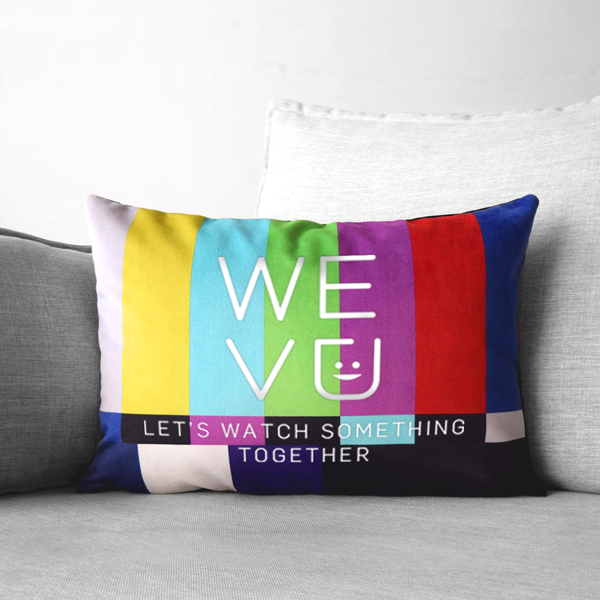 """Wevu logo on a couch pillow with the words, """"Let's watch something together."""""""