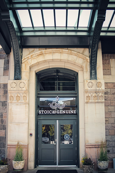 The logo over Stoic & Geniune's front doors.
